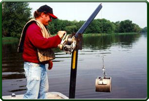 A Ponar device like the one shown here is used to collect samples of fingernail clams.