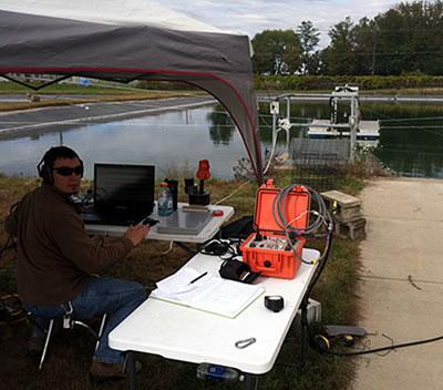 Figure 3: Scientist monitoring water gun operation.